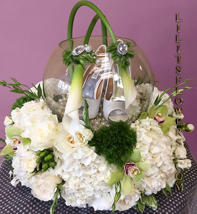Armenian style wedding shoes gift box - Just as the name suggest;                                                      this arrangement has every beautiful flower in the garden imaginable. Armenian floral arrangement.                                                          Make sure to share with us your arrangement.                                                         https://goo.gl/maps/Jgj1JeCetJv - Armenian Special arrangement wedding shoes gift box - Glendale Florist