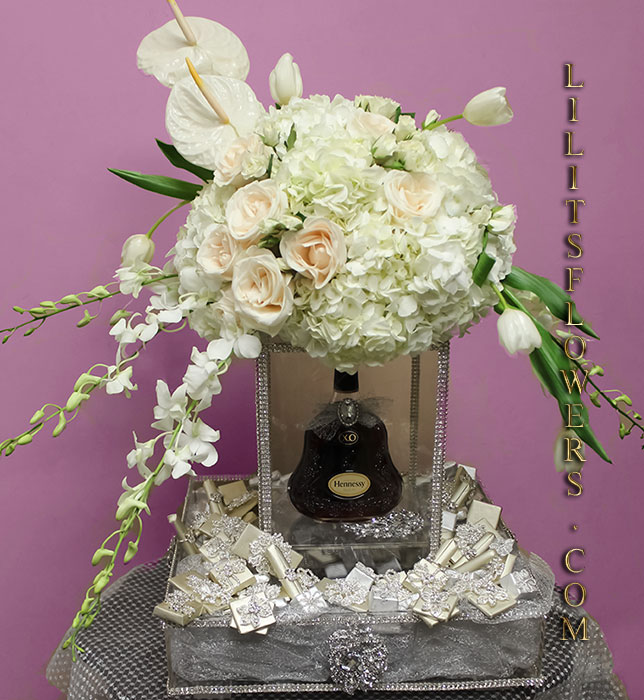 Florist in Glendale Flower Delivery - Wedding brandy and chocolate gift box with white flowers. 													Make sure to share with us your arrangement.                                                     https://goo.gl/maps/Jgj1JeCetJv - Purple roses, purple dendrobium orchid - Glendale Florist