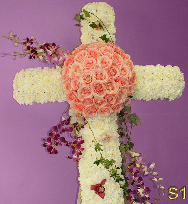 Funeral Florist in Glendale Flower Delivery -  beautiful flower                                                      arrangement funeral cross with pink roses, white carnations and more                                                     Make sure to share with us your arrangement.                                                     https://goo.gl/maps/Jgj1JeCetJv - Glendale Funeranl Florist pink roses