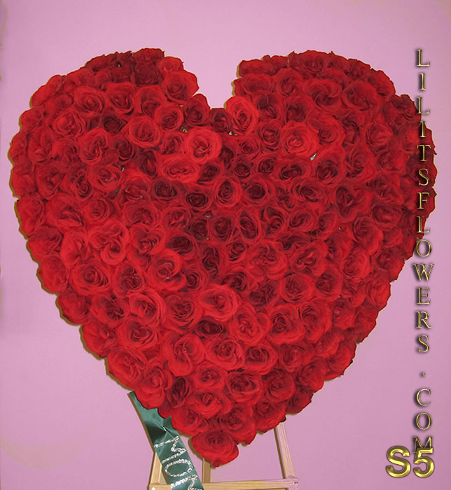 Sympathy Florist Delivery to Forest Lawn Hollywood Hills Burbank- stunning sympathy heart with red roses - Lilit's Flowers is the premier sympathy online flower shop for the Glendale and the surrounding towns. Order flowers online from Glendale Florist for same day local flower delivery from conveniently located shops in Southern California to send flowers to Glendale, Los Angeles,  Hollywood, Echo Park, Silver Lake, Atwater Village, Burbank, Sherman Oaks, La Cañada, Flintridge, Pasadena, San Marino, Alhambra, Arcadia, Thousand Oaks, Tarzana, Tujunga, La Crescenta,Toluca Lake, Burbank Hollywood Hills and more.  Make sure to share with us your arrangement.  https://goo.gl/maps/Jgj1JeCetJv - pink carnations and red roses - Glendale Florist Funeral heart for Forest Lawn Hollywood Hills, Burbanks