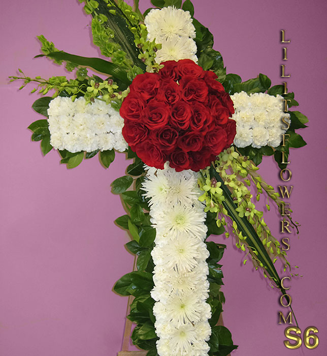 sympathy cross with white carnations and red roses