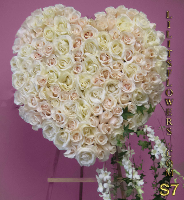 gorgeous funeral heart with white roses