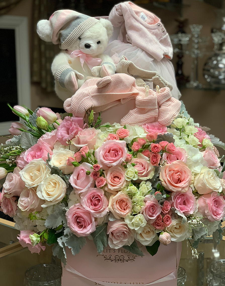elegant bouquet in the white pink box, pink veronicas, pink spray roses