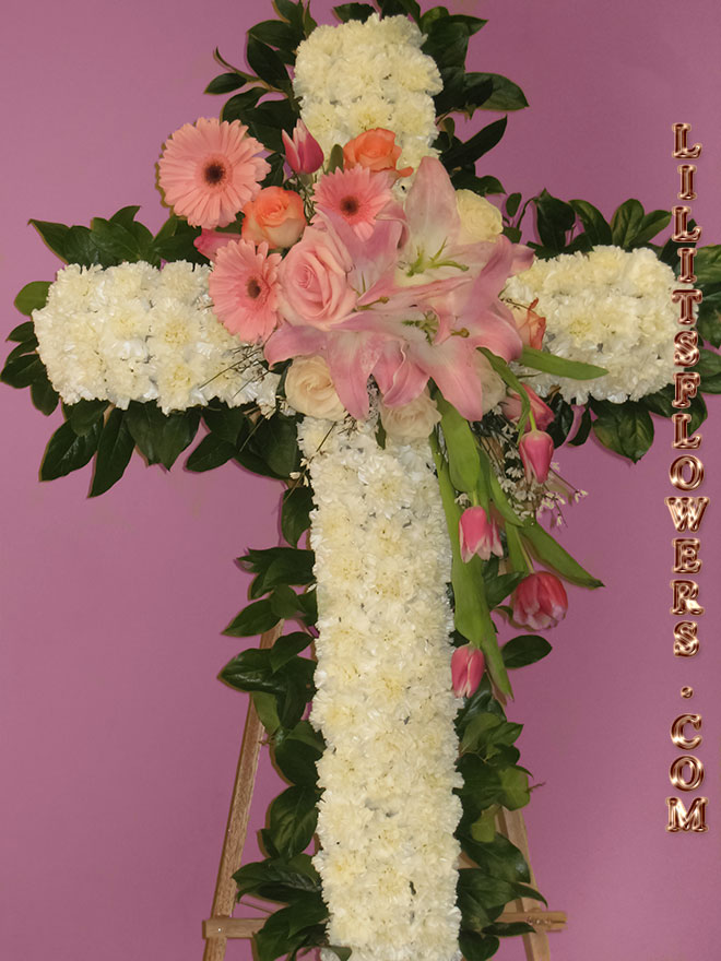 Funeral Florist in North Hollywood, CA Flower Delivery -beautiful funeral cross composed of pink roses, white carnations, pink gerbera daisy - Lilit's Flowers is the premier sympathy flower shop for North Hollywood and the surrounding towns. Order flowers online from Glendale Florist for same day local flower delivery from conveniently located shops in Southern California to send flowers to Glendale, Los Angeles,  Hollywood, Echo Park, Silver Lake, Atwater Village, Burbank, Sherman Oaks, La Cañada, Flintridge, Pasadena, San Marino, Alhambra, Arcadia, Thousand Oaks, Tarzana, Tujunga, La Crescenta,Toluca Lake and more.  Make sure to share with us your arrangement.  https://goo.gl/maps/Jgj1JeCetJv - cross pink and white flowers  - sympathy flowers North Hollywood