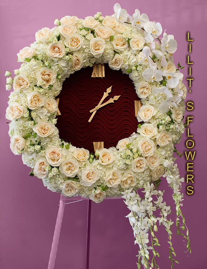 Funeral Florist in Los Angeles, CA Flower Delivery - beautiful spray  - beautiful funeral clock composed of white orchids and white roses- Lilit's Flowers is the premier sympathy flower shop for Los Angeles, CA and the surrounding towns. Order flowers online from Glendale Florist for same day local flower delivery from conveniently located shops in Southern California to send flowers to Glendale, Los Angeles,  Hollywood, Echo Park, Silver Lake, Atwater Village, Burbank, Sherman Oaks, La Cañada, Flintridge, Pasadena, San Marino, Alhambra, Arcadia, Thousand Oaks, Tarzana, Tujunga, La Crescenta,Toluca Lake and more.  Make sure to share with us your arrangement.  https://goo.gl/maps/Jgj1JeCetJv - white clock - sympathy flowers Los Angeles, CA