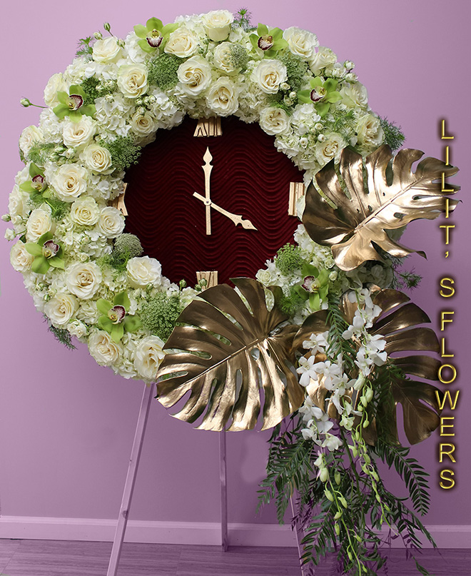 Funeral Florist in Los Angeles, CA Flower Delivery - beautiful sympanthy clock  - beautiful sympathy clock composed of white roses and white and green orchids- Lilit's Flowers is the premier sympathy flower shop for Los Angeles, CA and the surrounding towns. Order flowers online from Glendale Florist for same day local flower delivery from conveniently located shops in Southern California to send flowers to Glendale, Los Angeles,  Hollywood, Echo Park, Silver Lake, Atwater Village, Burbank, Sherman Oaks, La Cañada, Flintridge, Pasadena, San Marino, Alhambra, Arcadia, Thousand Oaks, Tarzana, Tujunga, La Crescenta,Toluca Lake and more.  Make sure to share with us your arrangement.  https://goo.gl/maps/Jgj1JeCetJv - white spray - sympathy flowers Los Angeles, CA
